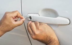 Picking lock on white car door