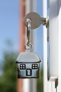 key in lock with house keychain