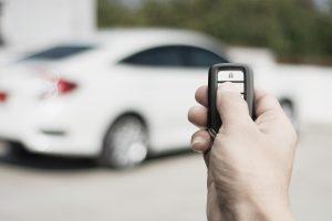 Hand using transponder to unlock car