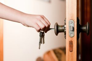unlocking a door at home